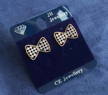 STAINLESS STEEL AND BRASS MATERIAL TOPS BOW DESIGN